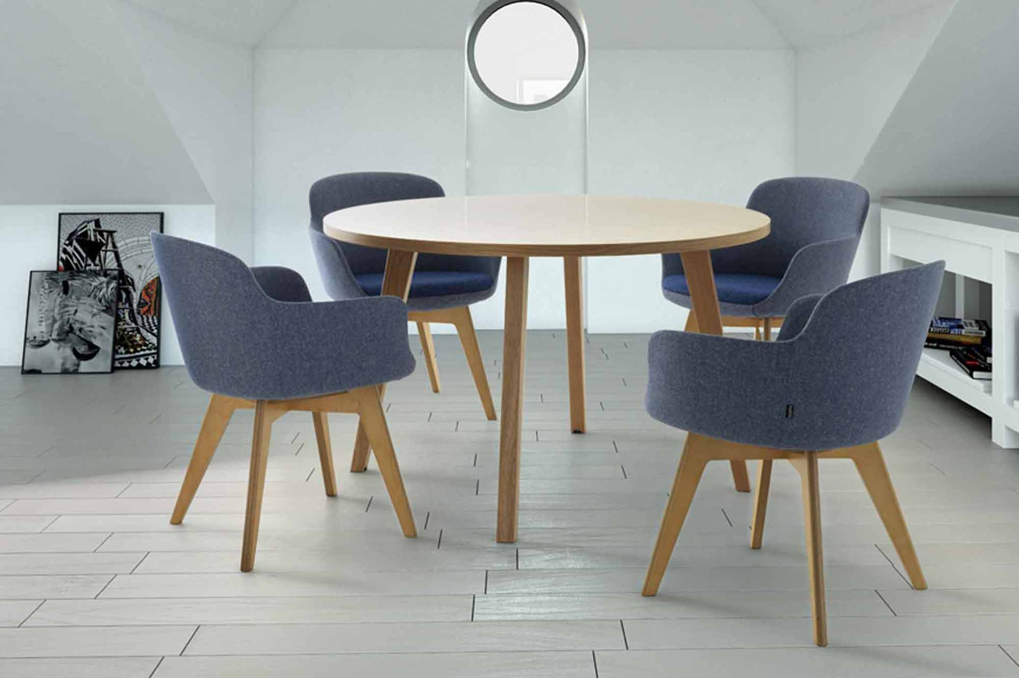 Casual meeting space in office with four chairs and wooden table