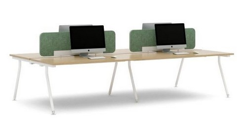 ACUTE bench desks with Mac computers